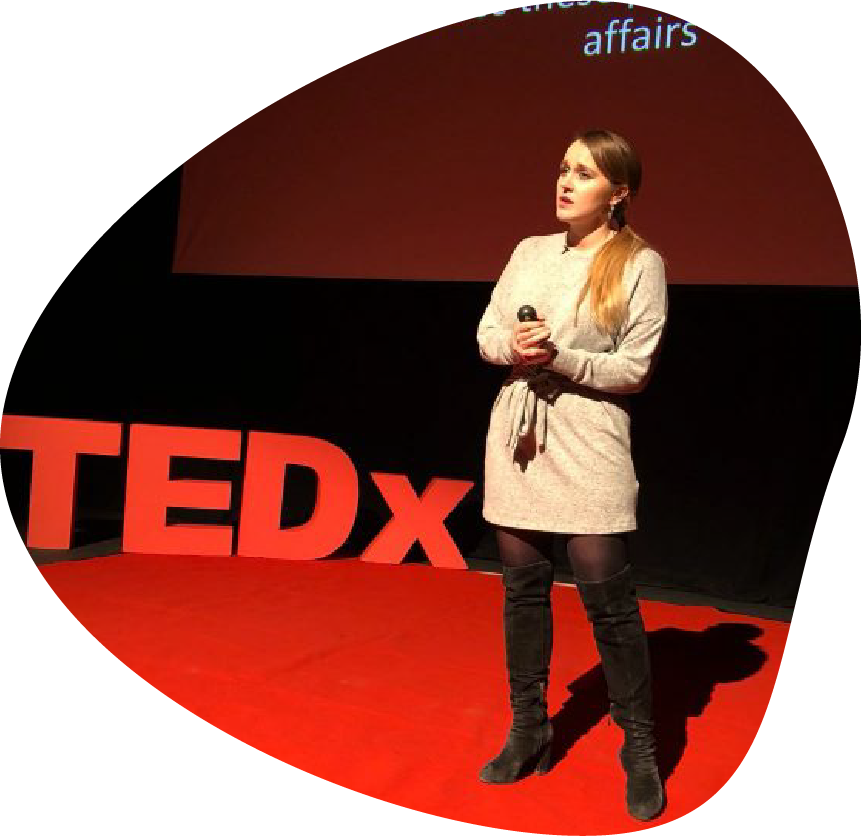 Lauren Windle Public Speaking at Tedx conference talking about her addiction recovery